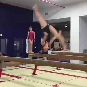 Young Gymnast Falls While Doing Front Aerial on Beam [Video]
