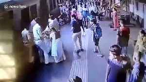 Two brave cops save women from slipping under moving train in Mumbai [Video]