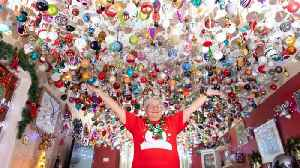 Belle of the bauble! Gran spends four months hanging 2,000 baubles worth �15,000 from living room ceiling [Video]