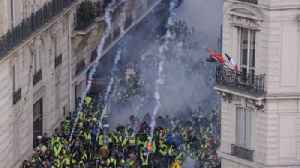 Paris protesters retreat as tear gas is fired [Video]
