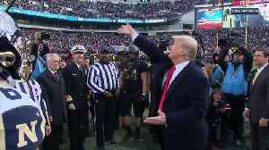 President Donald Trump performs Army Navy game coin toss