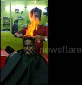 Drop the scissors! Indian barber trims customer's hair by setting it on FIRE [Video]