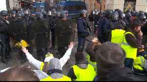 News video: French police fire tear gas at protesters in central Paris