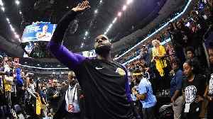 LeBron James Surprises Fan With Game-Worn Shoes [Video]