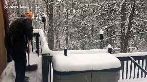 Time lapse shows snowfall in backyard of West Virginia home [Video]