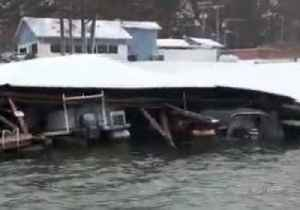 Marina Boat Houses Crushed by Heavy Snow in North Carolina [Video]