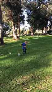 Toddler Plays Soccer with Dad [Video]