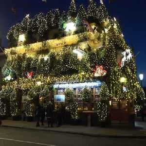 London pub decks its halls with 21,000 lights and 100 Christmas trees [Video]