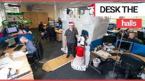 Is this the craziest Christmas office desk you've ever seen? [Video]