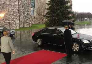 Theresa May Arrives for Meeting With Angela Merkel, Gets Locked in Car [Video]