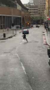 Biker Doing Wheelie in Middle of Street Faces Fall [Video]