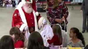 Melania Trump handing out toys at Toys for Tots event [Video]
