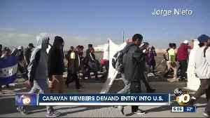 Caravan members demand entry into U.S. [Video]