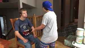 News video: Couple adopt FIVE children with Down Syndrome