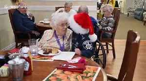 Child 'police officer' spreads Christmas cheer at nursing homes with hugs and flowers [Video]