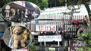 Teddy Bears Hanging From Car Repair Shop For 'Good Luck' [Video]