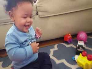 Baby gets a Case of the Giggles when Playing with Toy [Video]