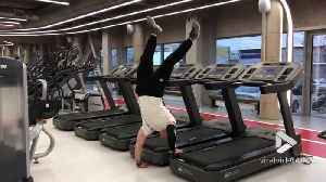 Treadmill handstand [Video]