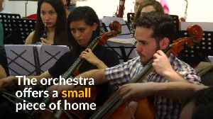 Venezuelan migrants find solace playing music in Argentina [Video]