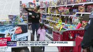 Detroit police officers bring Christmas joy to children of fallen and critically injured officers [Video]