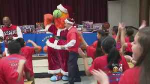 Spirit Of Christmas Spreads To HEAT Academy Students [Video]