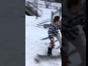 Snowboarder Crashes into Park Bench [Video]