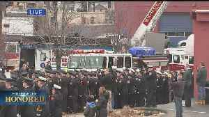 Casket Of Firefighter Roy Carried Into St. John's Church [Video]