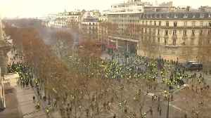 Police use teargas on 'yellow vest' protesters on Champs Elysees [Video]