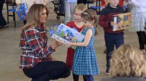 The First Lady Joins In Helping Toys For Tots [Video]