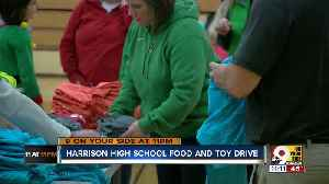 Harrison students spread holiday cheer in annual canned food drive [Video]