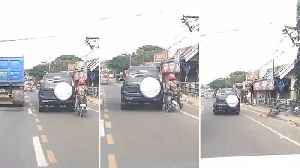 Car Clips Motorcyclist Onto Pavement [Video]
