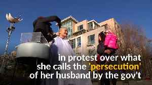 Chinese activists shave heads to protest 'persecution' of husbands [Video]