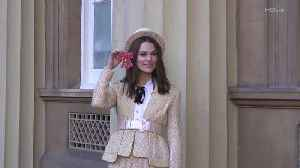 Right Now: Keira Knightley Sports a Chanel Tweed Top Hat as She Receives Honor from Prince Charles [Video]