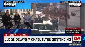 Flynn leaves court after a federal judge postponed his sentencing [Video]
