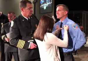 Burning Love: Firefighter Proposes to Girlfriend at Graduation Ceremony [Video]