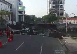 Main Road in Indonesian City of Surabaya Swallowed by Giant Sinkhole [Video]