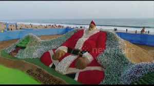 Indian artist creates 'world's biggest Santa' - with 10,000 plastic bottles [Video]