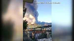 Child looks on as Mount Etna erupts [Video]