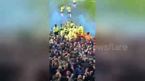 Chaos at Villa Park as Leeds grab late winner with flares thrown on the pitch and fans piling towards players [Video]