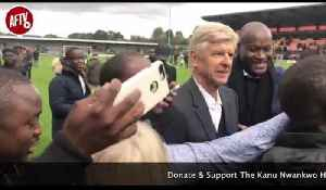 Arsene Wenger Mobbed By Fans After Kanu Cup Pitch Invasion At Full Time! [Video]
