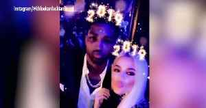 Khloé Kardashian and Tristan Thompson Share a Midnight Kiss While Spending NYE in Cleveland [Video]