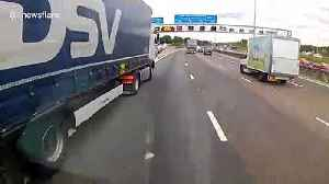 Dash cam footage shows lorry almost causing major accident on busy UK motorway [Video]