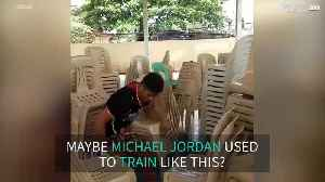 Basketball player trains with...chairs [Video]