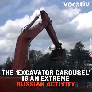 Russians Are Swinging Around on Excavator Shovels Because Russia [Video]