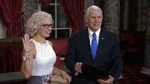 Sen. Sinema takes oath of office on a law book, instead of Bible [Video]