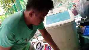 Escaped zoo python caught in family's laundry room [Video]