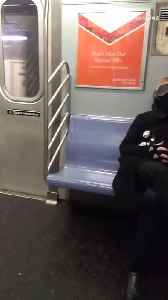 News video: Man in black jacket with eyes covered asleep
