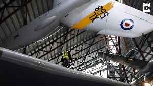 Winging it! Daredevil cleaners suspend themselves 200ft in the air – to dust RAF planes [Video]