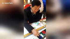 Skilful man shows off 'Dragon-Phoenix calligraphy' at a Chinese mall [Video]