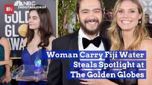 The Golden Globes Fiji Water Woman Becomes Famous Photobomber [Video]